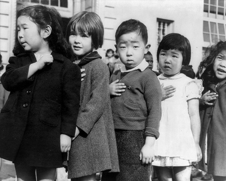 Children at the Weill public school in San Francisco pledge allegiance to the American flag in April 1942, prior to the internment of Japanese Americans