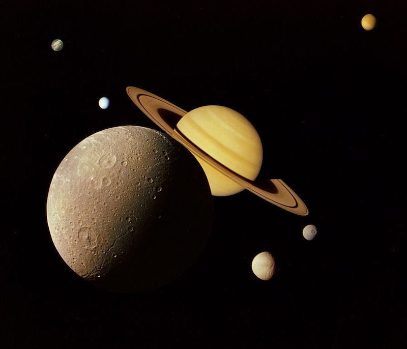 A montage of Saturn and its principal moons (Dione, Tethys, Mimas, Enceladus, Rhea and Titan; Iapetus not shown). This famous image was created from photographs taken in November 1980 by the Voyager 1 spacecraft